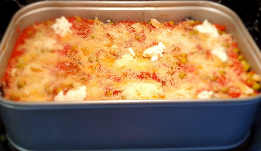 parmigiana di melanzane in cottura
